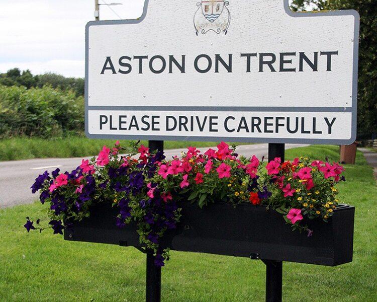 Plantscape village welcome sign